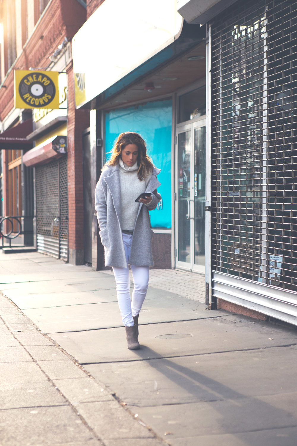 Winter Whites  Wearing: Brandy Melville sweater ( similar ) and coat ( similar ),  jeans ,  booties .