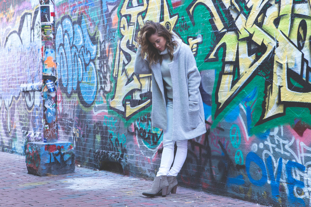 Wearing: Brandy Melville sweater ( similar ) and coat ( similar ),  jeans ,  boots .