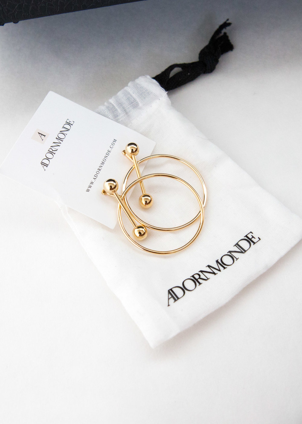 Gold AdornMonde earrings from the  BOS