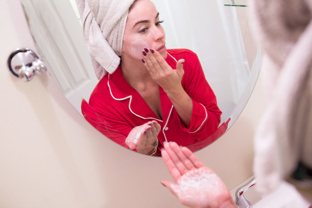 Applying the  Beautycounter Cleansing Balm  in  my PJs