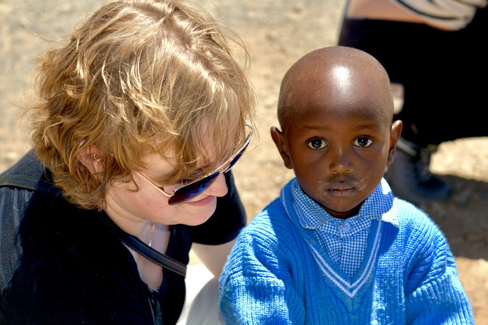 YBCer Laura with little Alex (3 years old) at a school at the Nanyuki  Spinners and Weavers Initiative