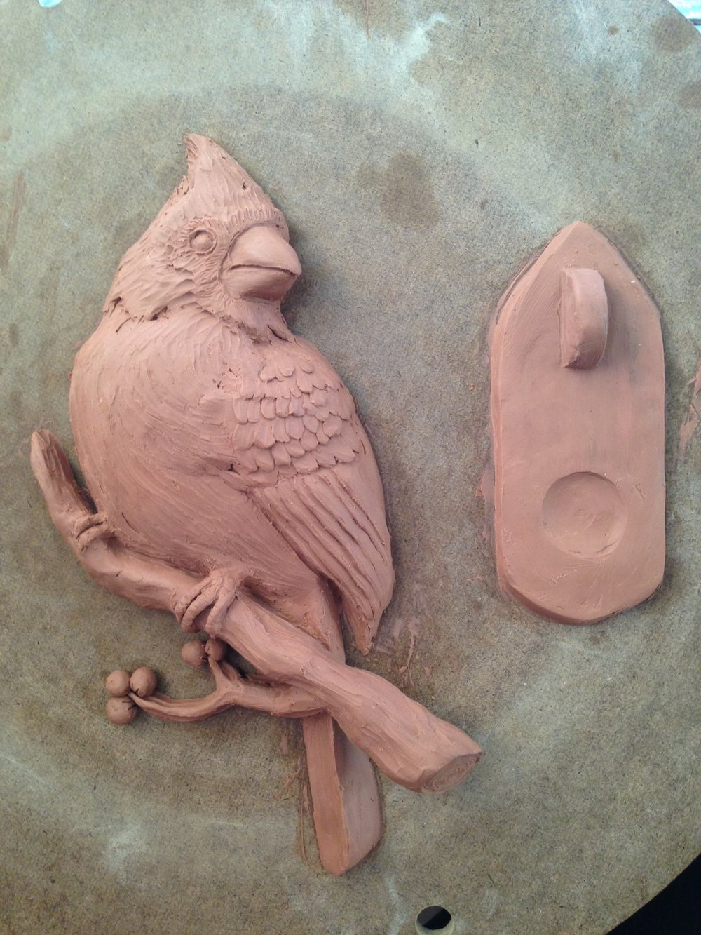 clay model of cardinal and knocker section