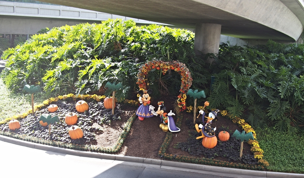Mickey & Minnie are in their regal Halloween outfits. Donald Duck looks happy in his wizard outfit.