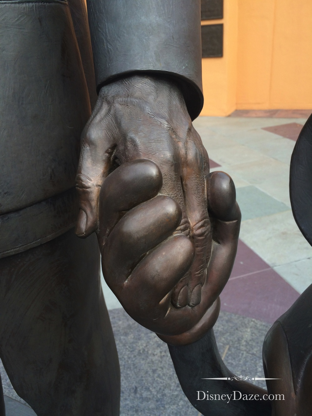 It is said that Blaine Gibson spent much time thinking about how he would sculpt Walt holding Mickey's hand.