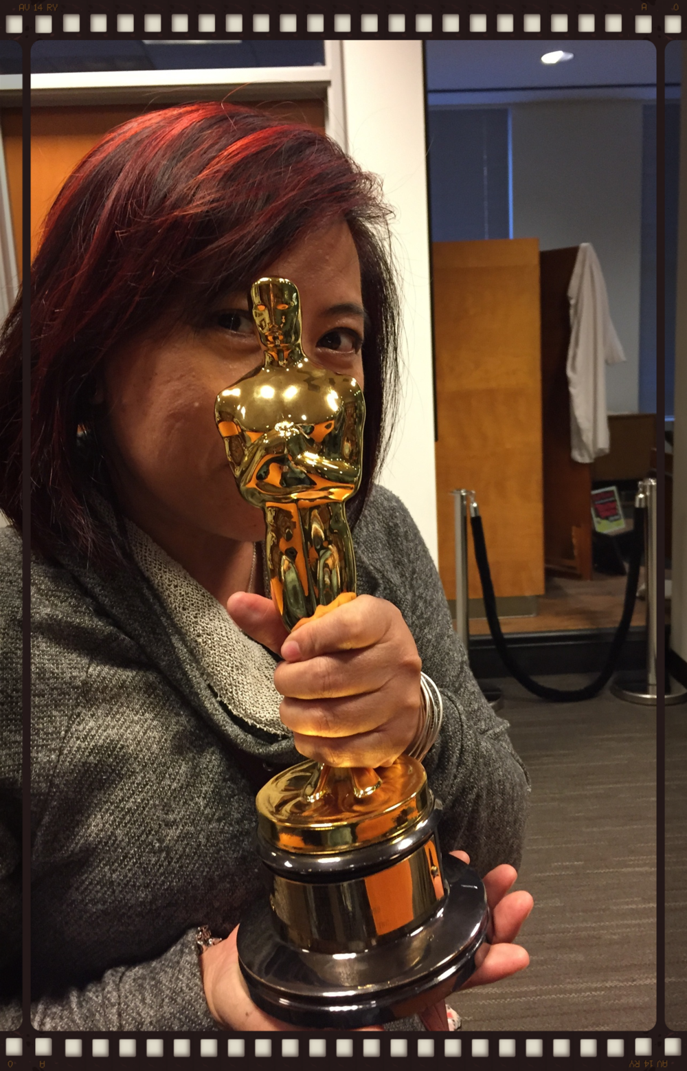Me holding one of Walt Disney's Oscars at the Walt Disney Archives (Burbank, CA)
