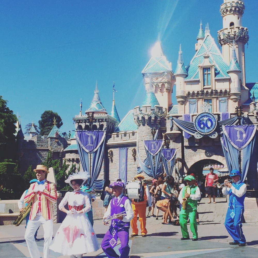 Mary, Bert, and Friends perform in front of bedazzled Sleeping Beauty Castle.