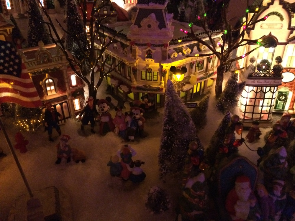 Dept 56 Disneyland Firehouse and Disneyland Emporium (not Dept 56). Disney Parks figures of Mickey & Minnie with Disney Parks family (Dept 56)