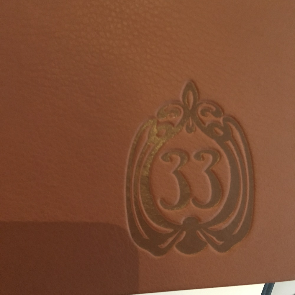 Embossed logo on menu book