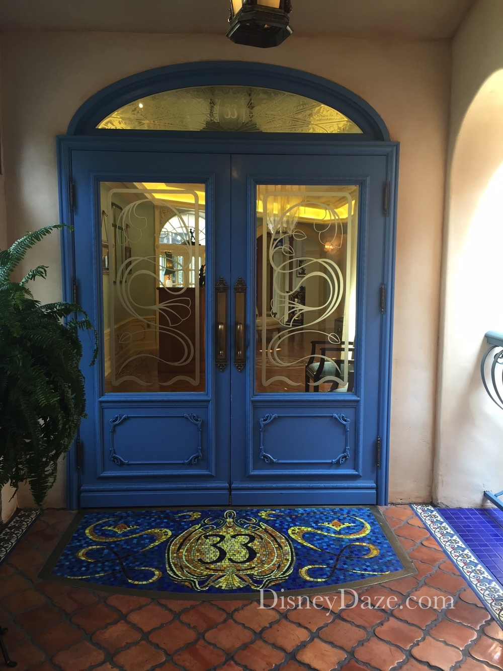 "Back entry door complete with mosaic tile Club 33 ""mat""."