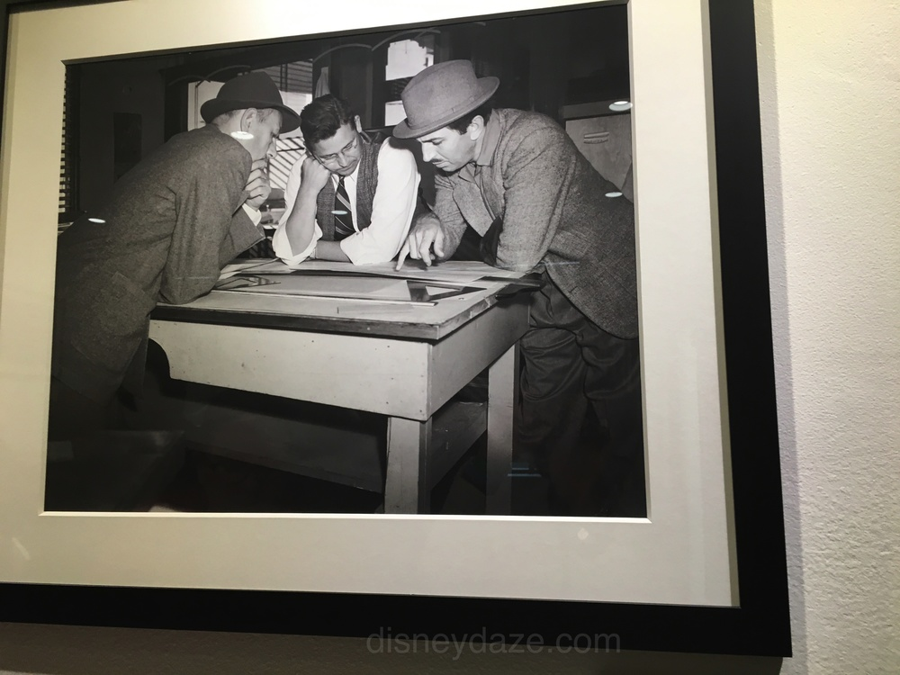 Photo of Kem Weber & Walt Disney discussing the office furniture