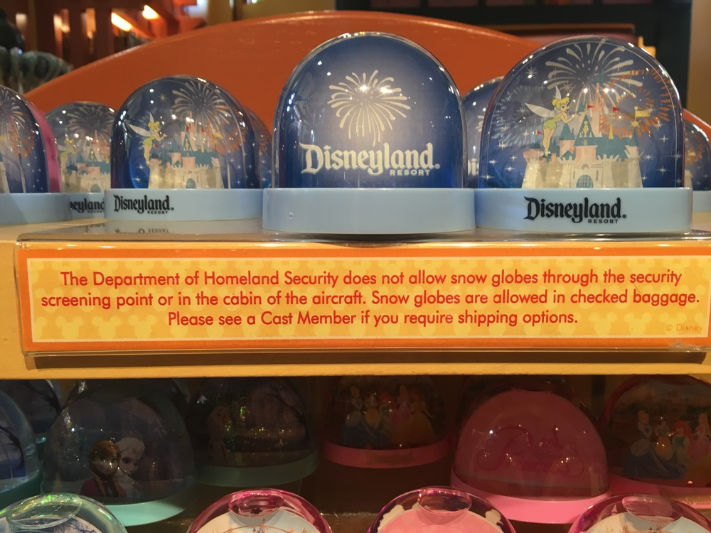 Some Disney signage about traveling snow globes.