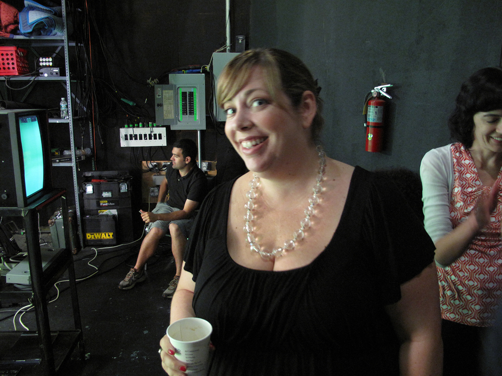 Lisa Esselstein producing the promo and drinking coffee...all smiles.