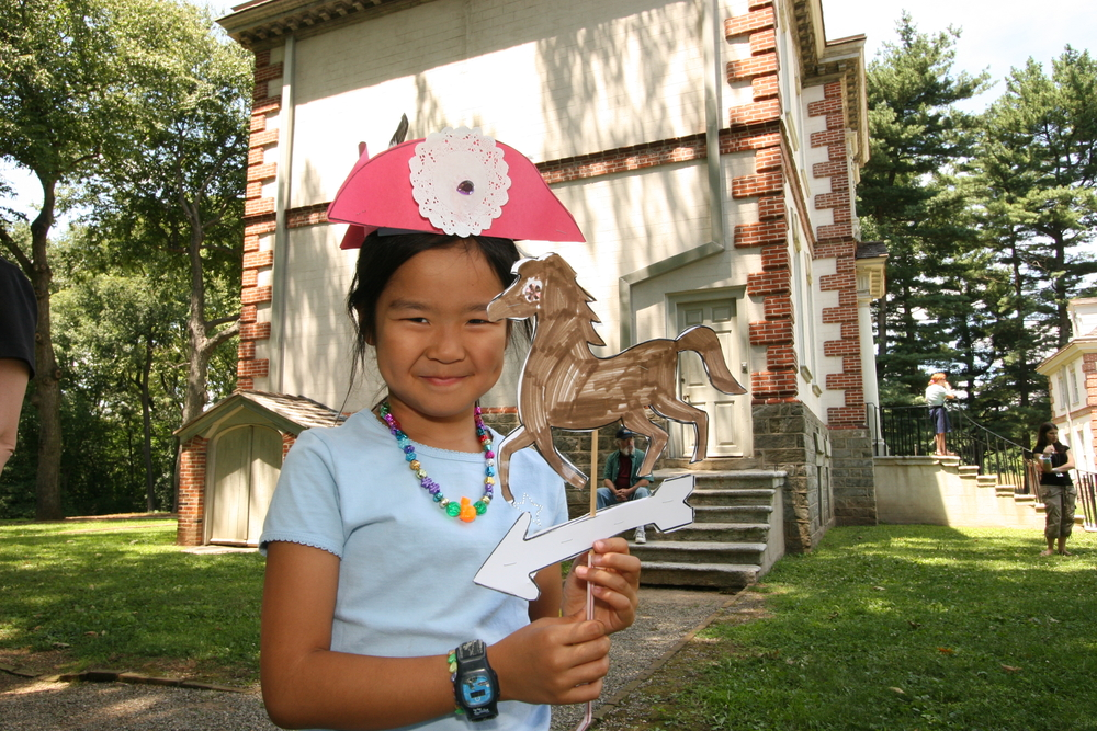 A young visitor makes a weathervane at Mount Pleasant
