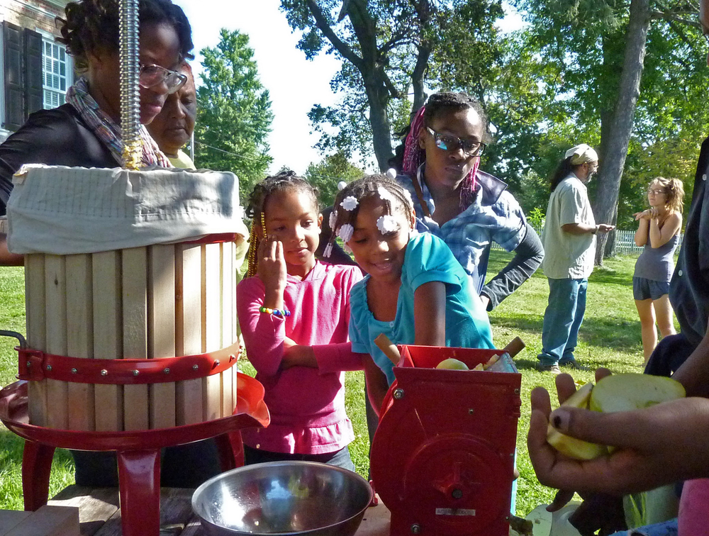 Families learn about the Ciderpress