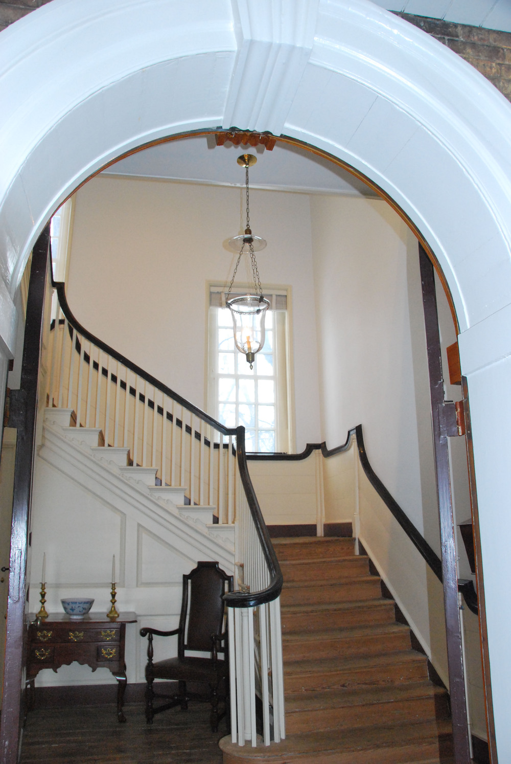 The staircase as seen through the arched doorway at Woodford.