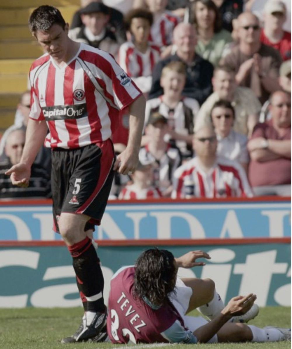 TAKE THAT:  CHRIS MORGAN LEAVES CARLOS TEVEZ IN NO DOUBT WHO IS BOSS DURING THE BLADES 3-0 WIN AGAINST WEST HAM AT BRAMALL LANE IN APRIL 2007. A FEW WEEKS LATER IT WAS TEVEZ WHO HAD THE LAST LAUGH.
