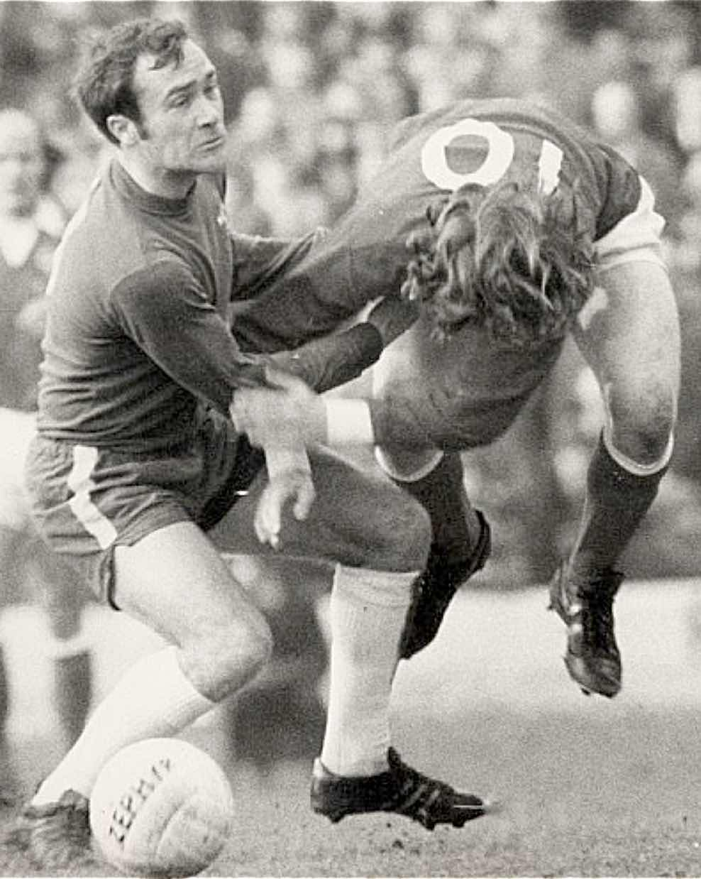 FOR THE CHOP : Chelsea's  Ron Harris deals with stan bowles in the way he knows best.