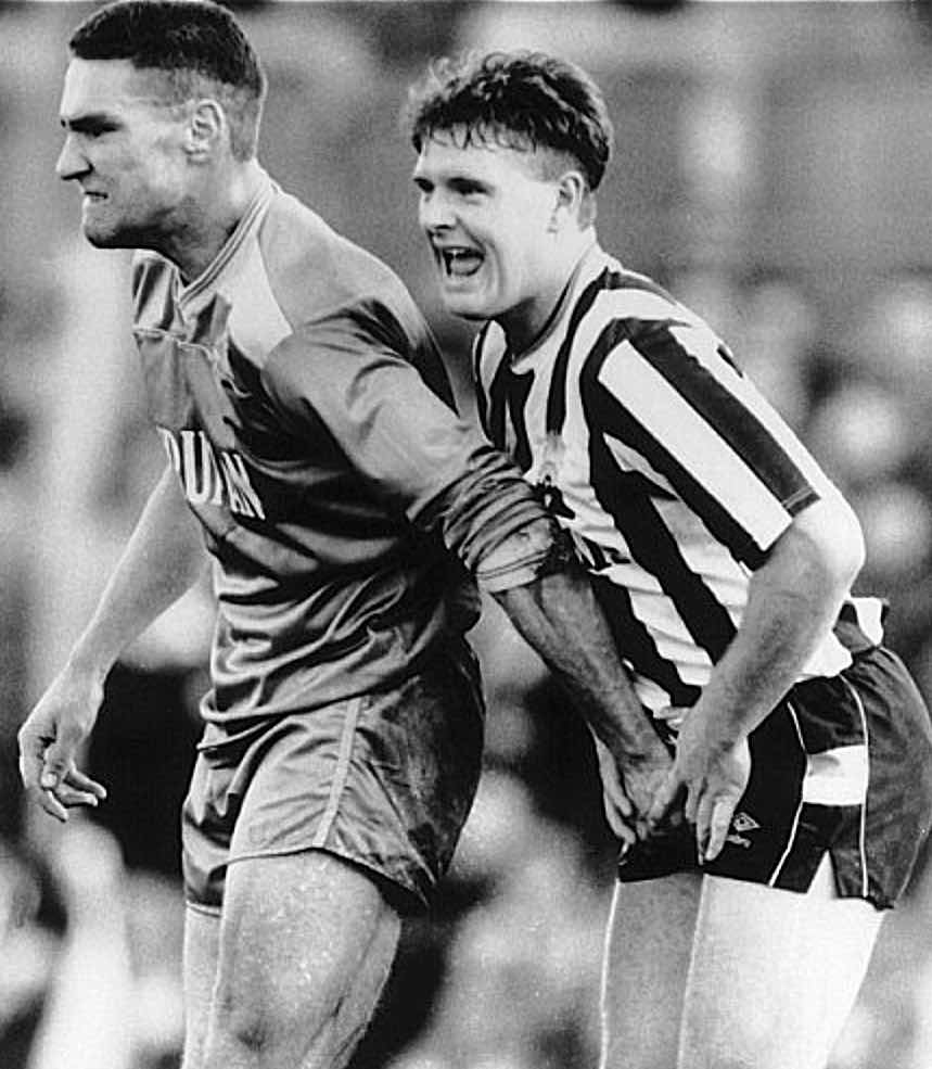 TOO CLOSE FOR COMFORT:  Geordie Paul Gascoigne feels the love from WIMBLEDON'S VINNIE JONES.