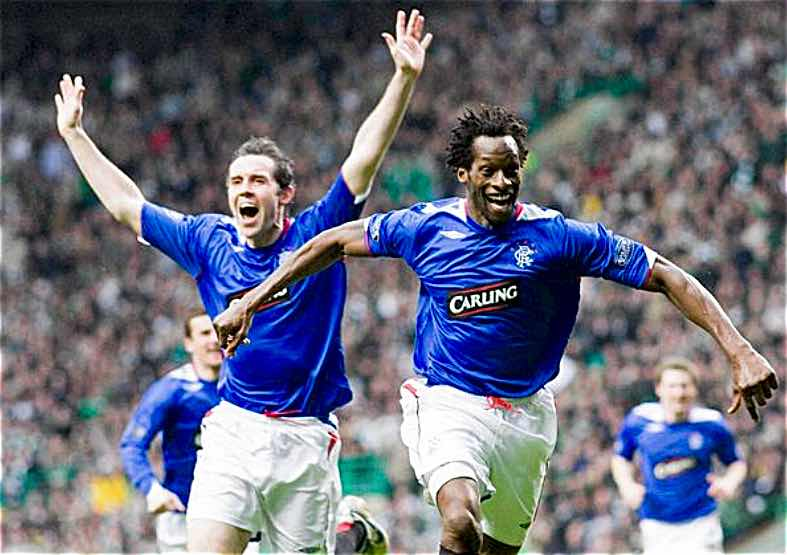 MAGIC MOMENT:  EHIOGU AND DAVID WEIR CELEBRATE AFTER UGO'S BYCYCLE KICK SECURED VICTORY FOR RANGERS AT CELTIC