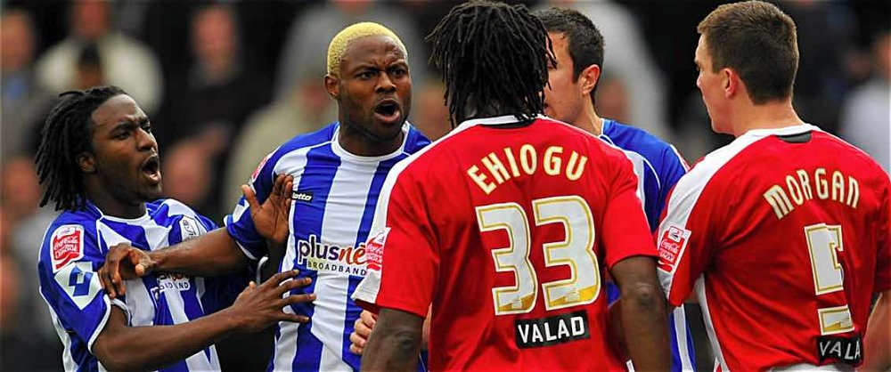 LOCAL DISPUTE:  EHIOGU AND SHEFFIELD WEDNESDAY'S AKPO SODJE HAD A DIFFERENCE OF OPINION AT HILLSBOROUGH.