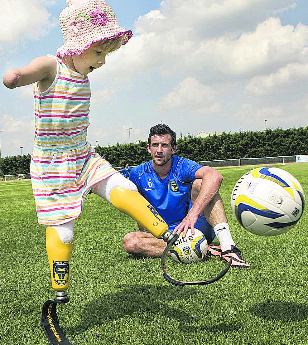 PROUD MOMENT - Wright when captain at Oxford United helped raise cash to buy eight-year-old Charlotte Nott running blades so she can take part in sport. Charlotte lost her lower legs and arms after contracting meningitis as a baby.