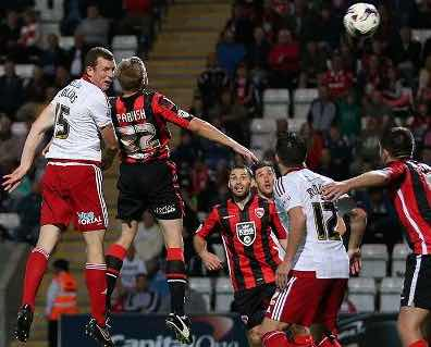 HEADS I WIN:  EMOTIONAL MOMENT THAT MEANT SO MUCH TO NEILL COLLINS AS HE HEADS WINNER FOR SHEFFIELD UNITED AT MORECAMBE.