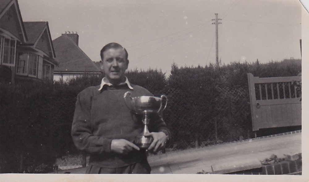 Picture of Albert Robert Mertens, Shaldon Regatta 1957, which shows him holding a trophy (it's believed that he sailed a Redwing).