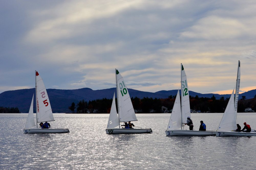 Yifu and Jacky (boat 5) lead Henry L and Faith (boat 10), a Brewster team (boat 3/12), and Wyatt and Irena (boat 7).  Gunstock Mountain in background.