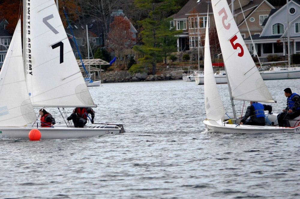 Wyatt and Irena lead Yifu and Jacky around the windward mark.