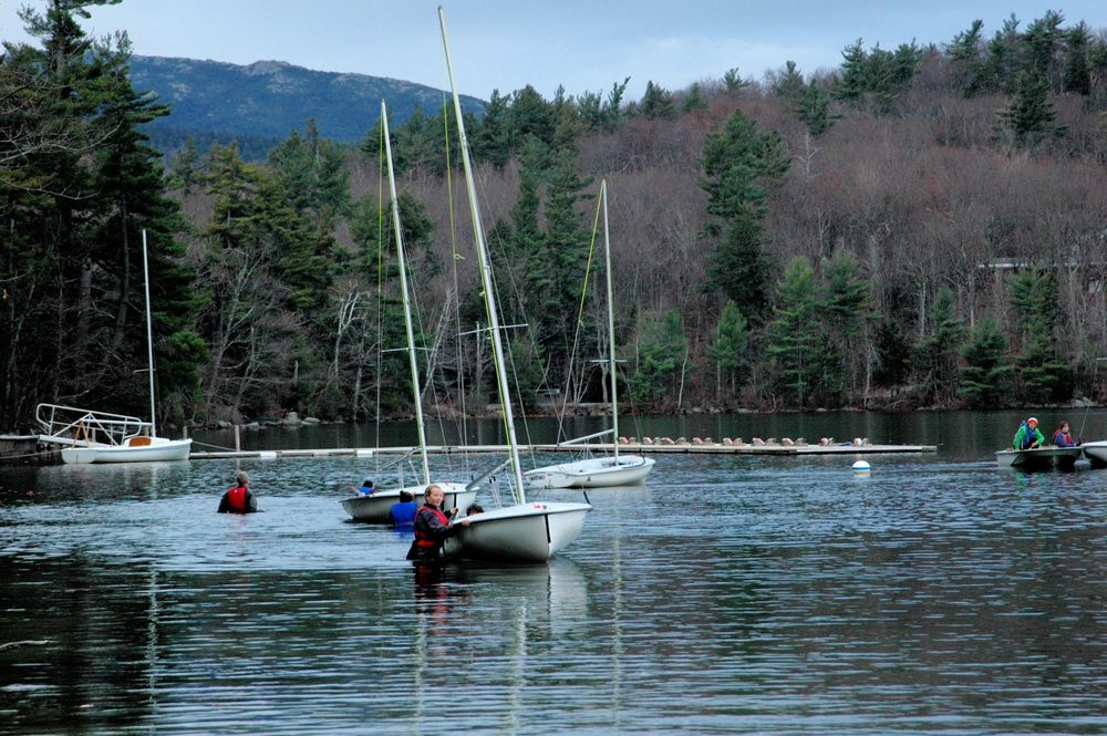 The swimmers empty the sailing dock while Mt Monadnock -and Yifu and Maggie in the motorboat- look on.