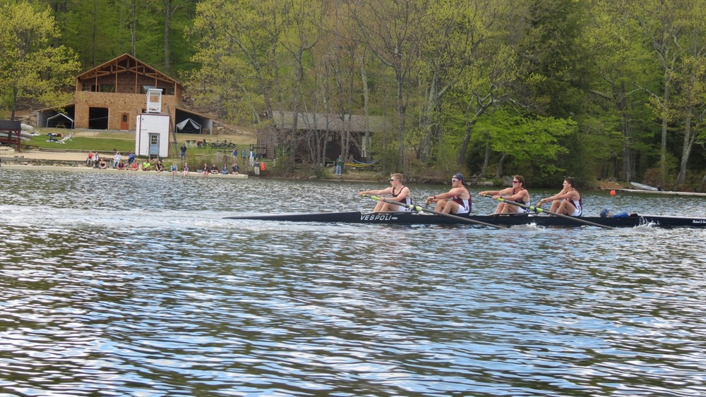 The Boys' 2nd Varsity heading past the Steele Family Boathouse with a strong lead.
