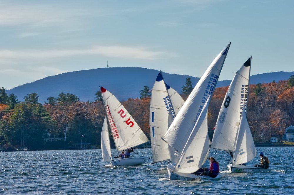 A Division on a downwind leg. Aidan and Irena in boat 5 and Silas and Taya in boat 8.