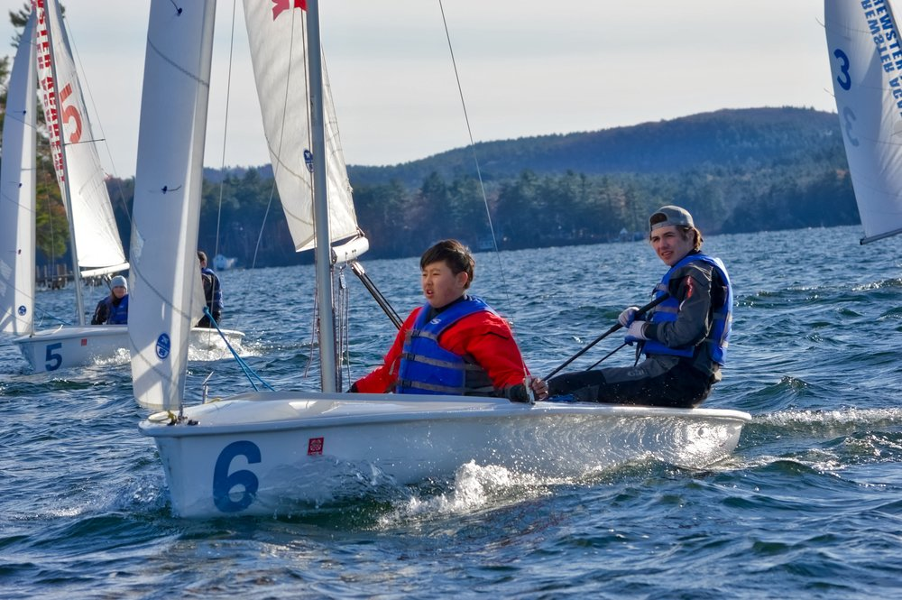 Jack and Jacky maneuvering in white caps before a race start.