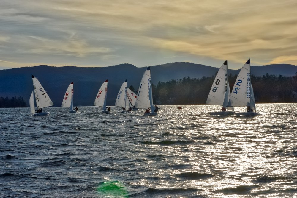 The A Division fleet running from the windward mark in a strong breeze. Gunstock Mountain in the background.