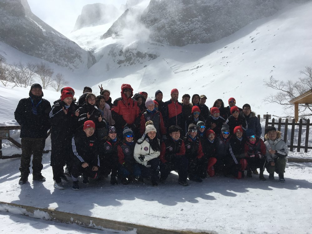 Posing with our new Chinese friends at Changbai Mountain. North Korea is just over the ridge behind us.