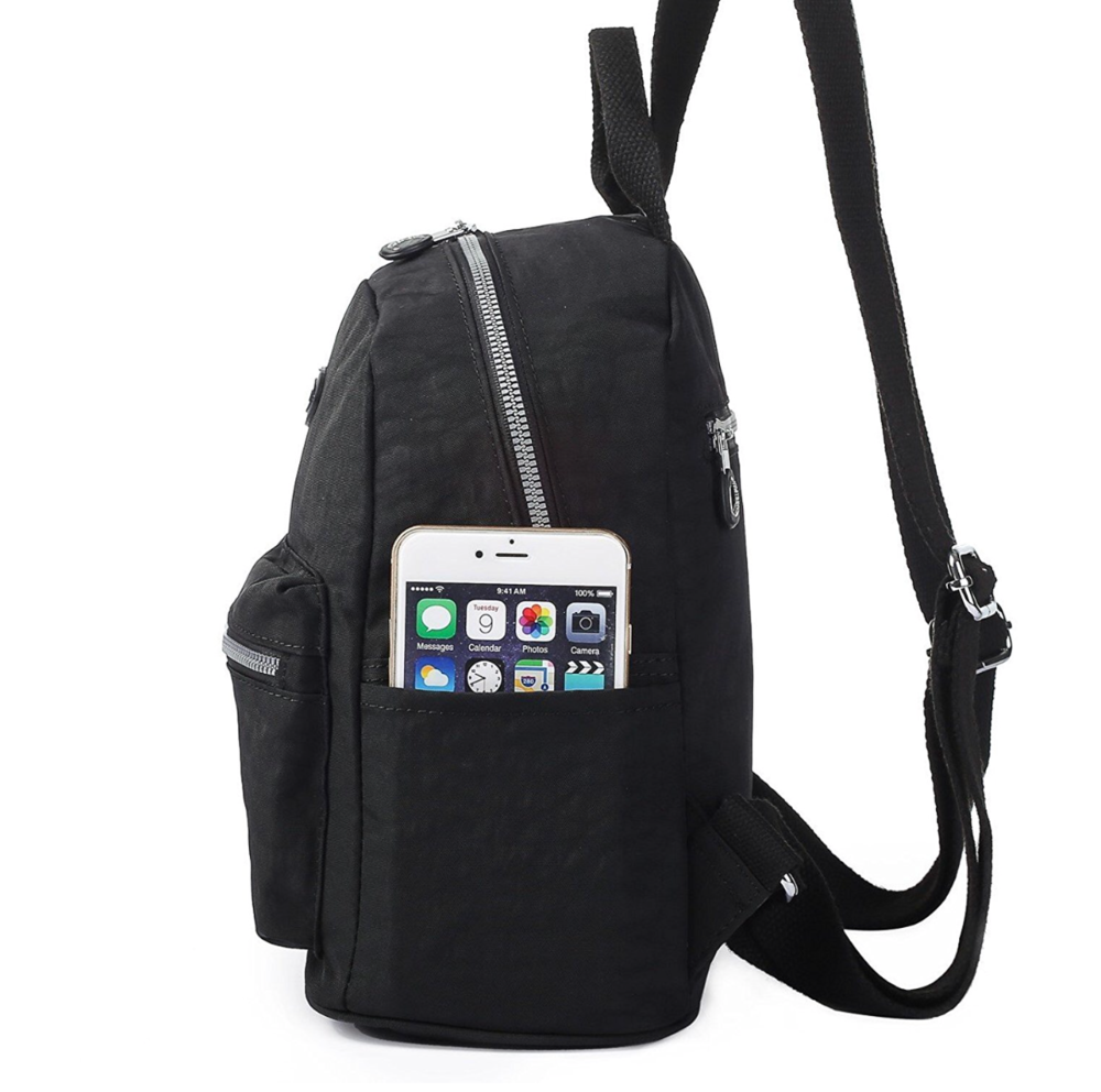 So I bought a black backpack. - It's a functional backpack. I tried it on with a few outfits and it's cute. It'll fit passports, lipgloss, cellphone, earbuds, a neck pillow and I'll be hands free and matching. I can also hold it by the handle if I feel a pickpocketer hovering.