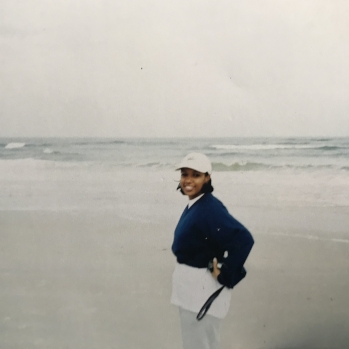 Me revealing a barely there baby bump in St. Augustine, Florida circa Winter 2002.