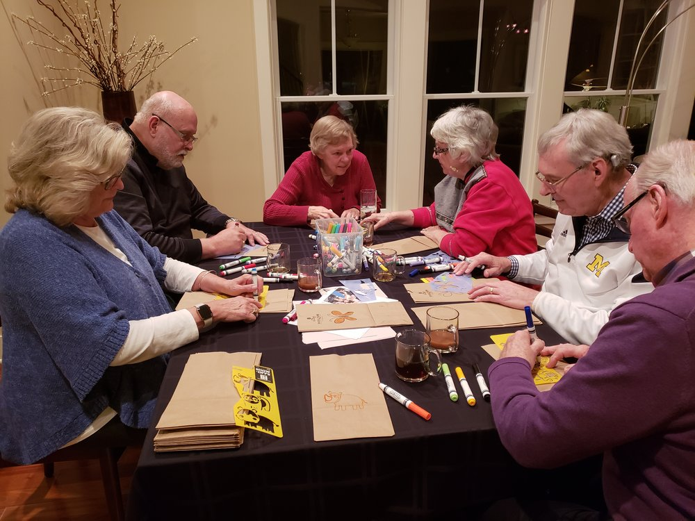 Roger & Kristen Kennedy's city group decorating lunch bags for Kids Food Basket!