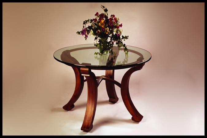 "Dining Table Size Shown: 42"" Dia. x 28 1/2""H 48"" Dia. Glass Top Burnished Iron Finish"