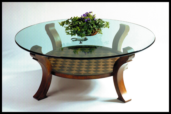 "Cocktail Table Size Shown: 44"" Dia. x 20""H Burnished Iron Finish"