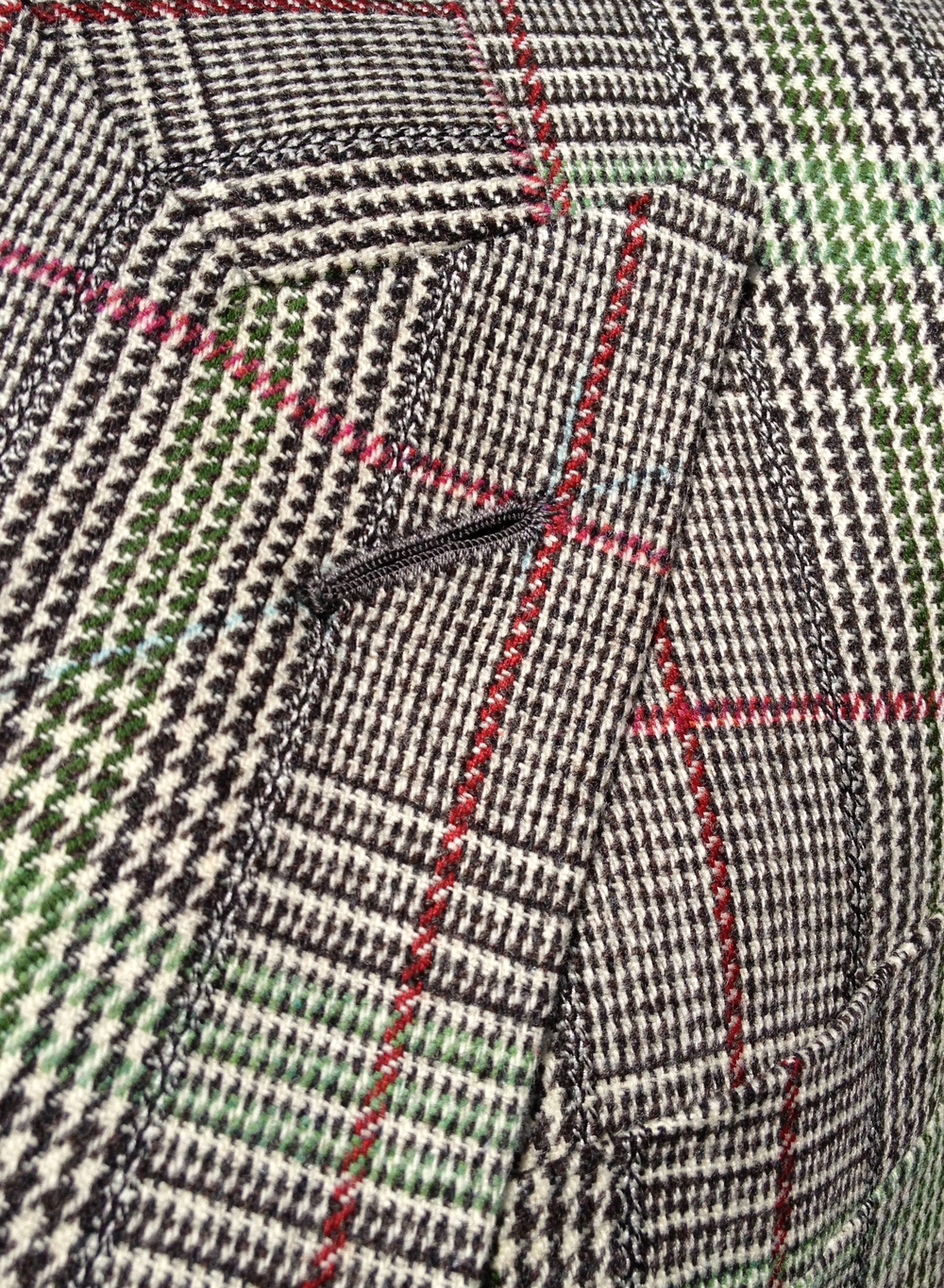 Fox Brothers Flannel. Distinctive red and green overchecks on a classic prince of wales ground.