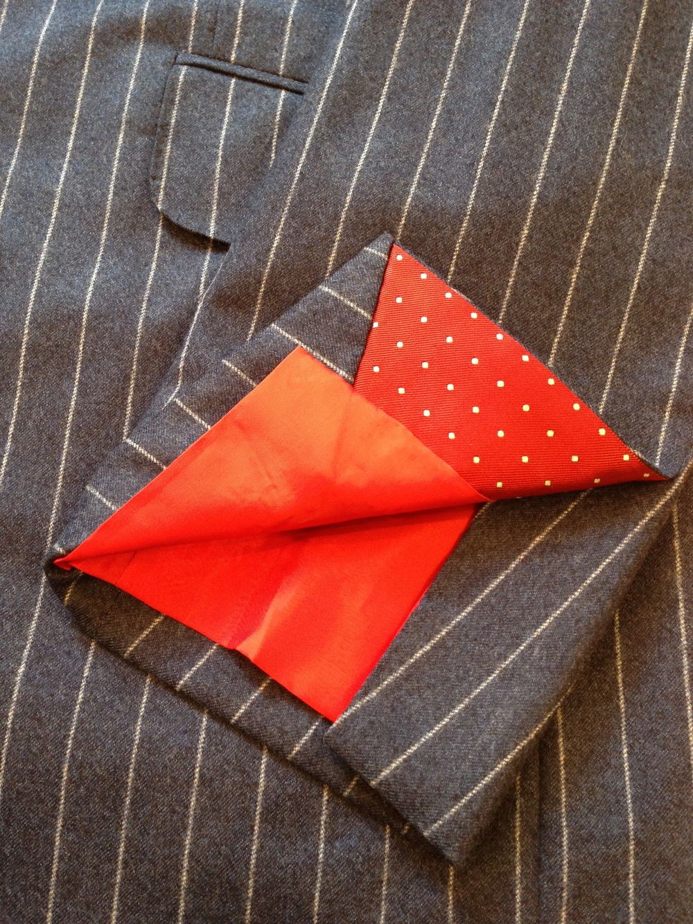 Blue striped Cacioppoli spring weight flannel with red and white silk polkadot cuff inserts.