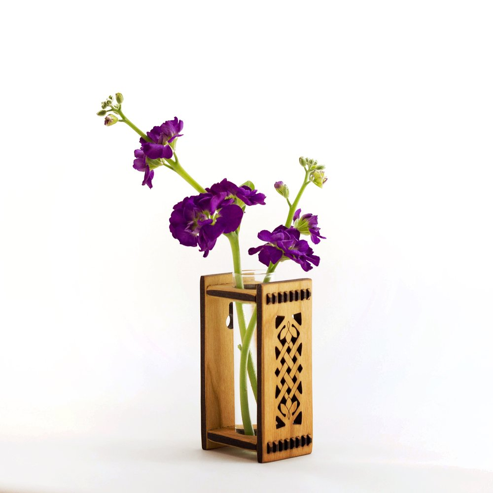 1. Bud Vase - My bud vases are designed to hang on a wall, but they are stable enough to set on a countertop. They are light weight and can even be hung with Command strips, which are often the preferred hanging method for dorm rooms or apartments. They are functional, beautiful, and well suited for small spaces!