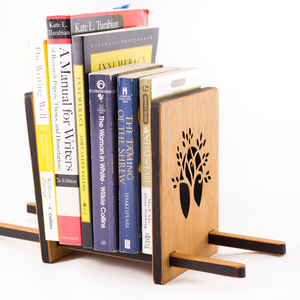 3. Sliding Book Stand - If more books are in your graduate's future, the sliding book stand might be just the thing they need. The stand adjusts to hold a lot of books, or just a few. Backpacks can get heavy fast, and having a dedicated freestanding bookshelf that can adjust to the changing amounts of books can help keep your graduate organized.