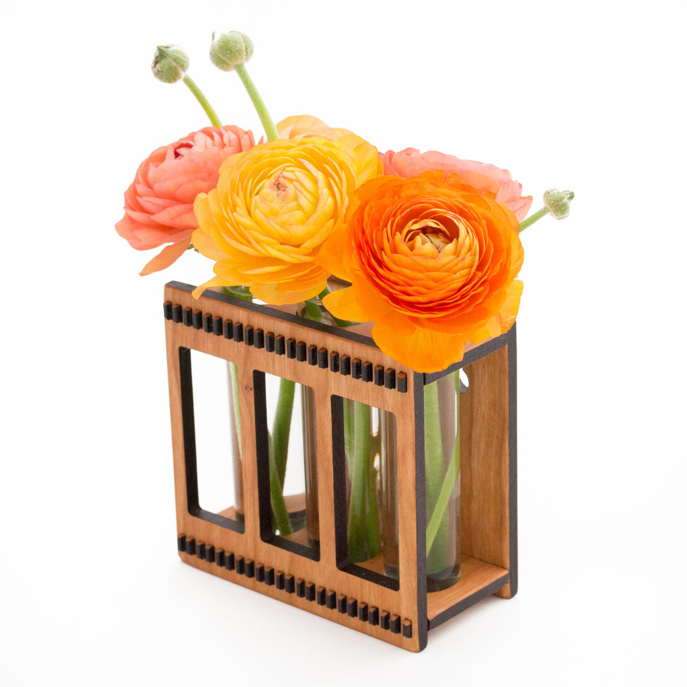 1. Triple Flower Vase - Holds a few small flowers, hangs on the wall, or sits on the countertop. Beauty, simplicity, and nature, all in one.