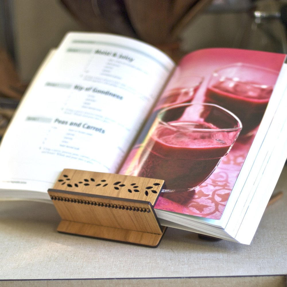 2. Cook Book Stand - If you're making soups, stews, roasts, or anything warm, cozy and comforting, this cook book stand holds your book open for you.