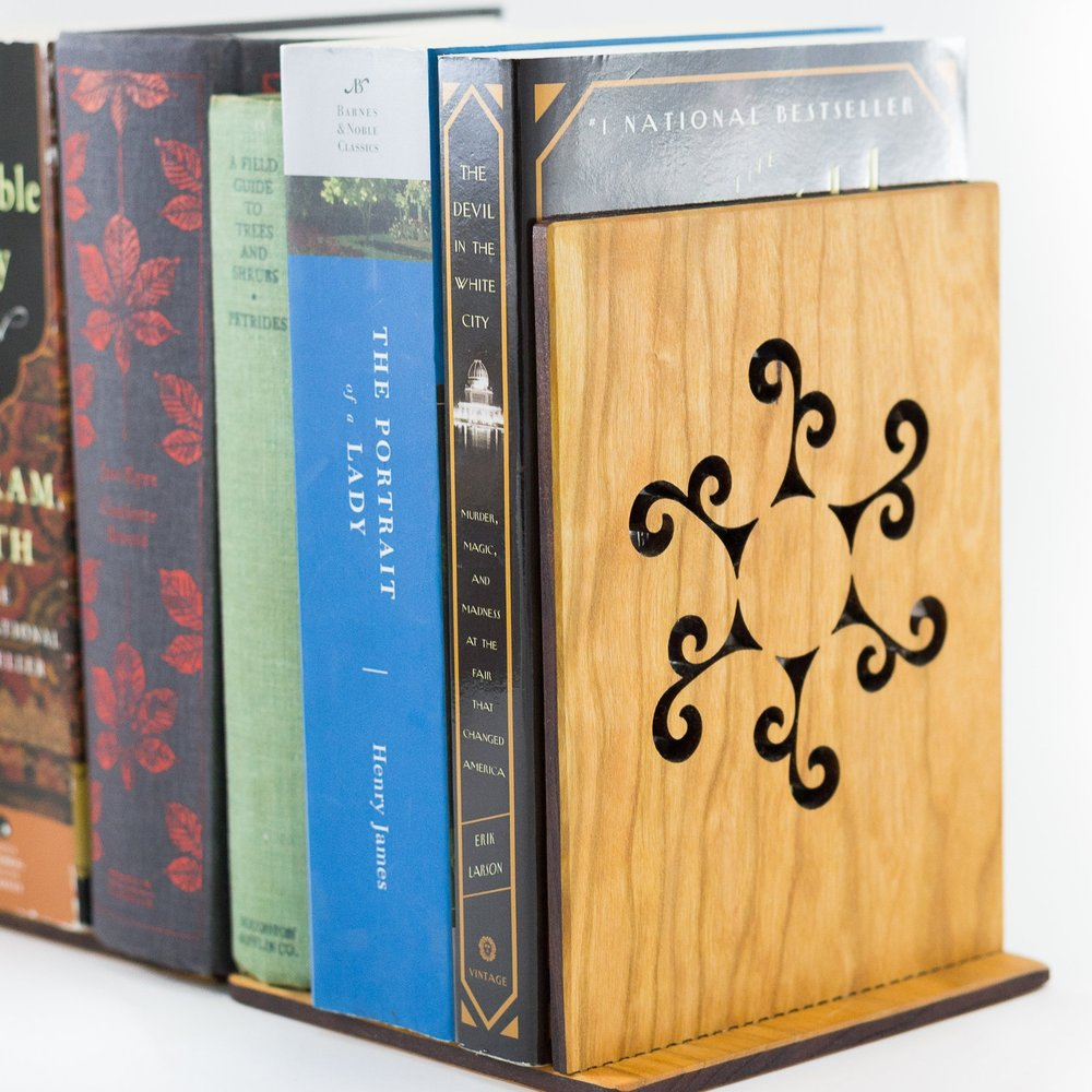 3. Book Ends - Classics, thrillers, mysteries, romance, book ends keep all your books neatly organized.