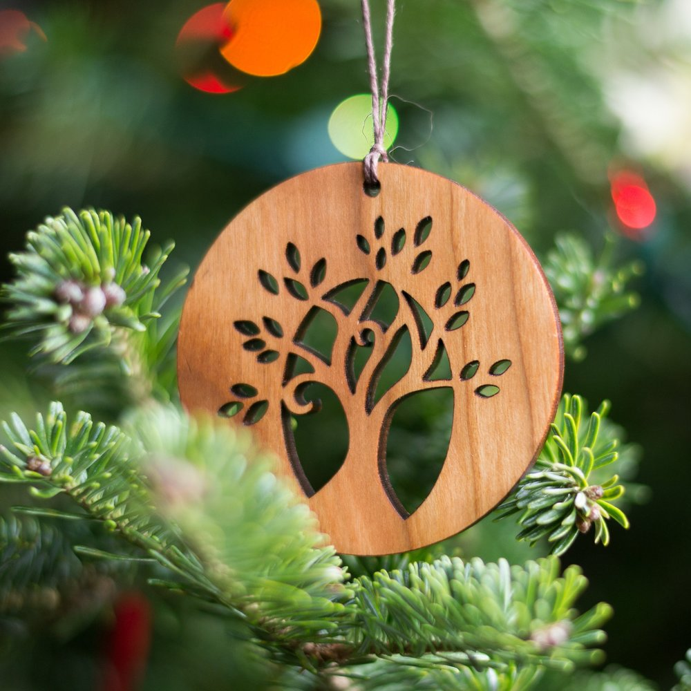 2. Ornament - Ornaments are a classic gift! Many people decorate their Christmas trees with ornaments gifted to them by friends and family. These ornaments are all handmade in Pennsylvania from sustainably harvested solid cherry wood. A perfect thank you gift for the folks who are hosting you at Thanksgiving.
