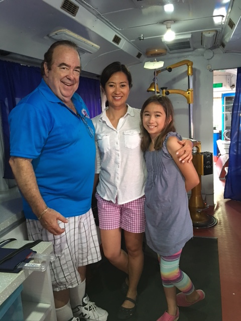 Dr. James Weyrich, Dr. Lyndi Schmidt, and Dr. Schmidt's daughter Nina on their first day of the EyeCare WeCare Mission in the Philippines.