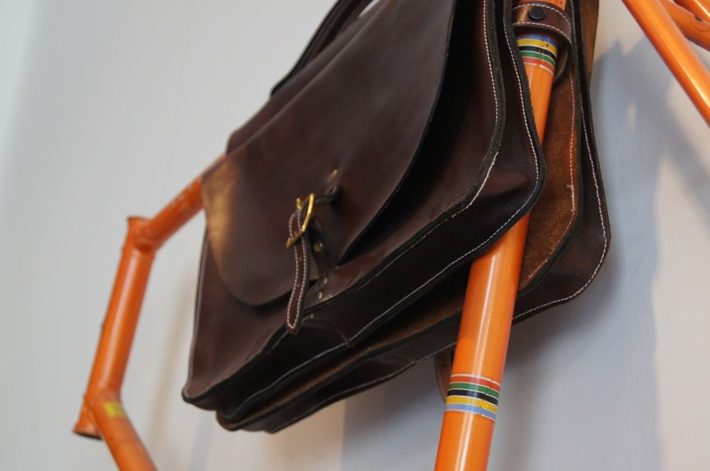 Locally made leather top tube bag for bikes without cargo racks.